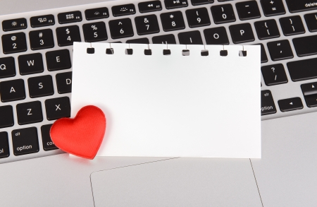 red hearts and sticky note on Laptop keyboard photo