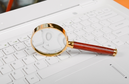 Laptop with a magnify glass photo