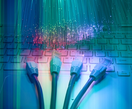 wan: network cable closeup with fiber optical background