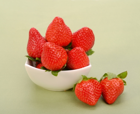 Strawberries in white bowl photo
