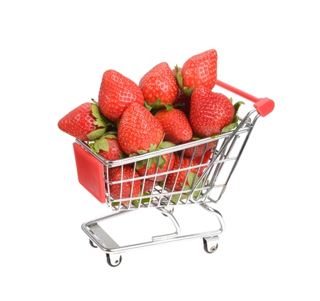 super market: Shopping cart filled with fresh strawberries isolated over white