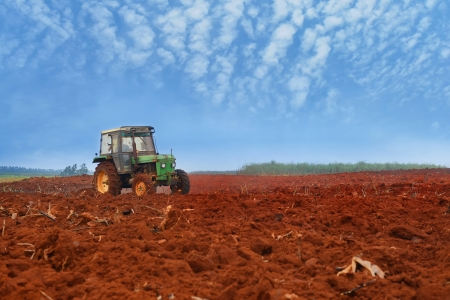seeding: tractor cultivatin soil ready for seeding in spring Stock Photo