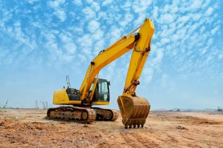 excavator: excavator loader machine during earthmoving works outdoors