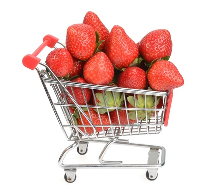 Shopping cart filled with fresh strawberries isolated over white Stock Photo - 18805314