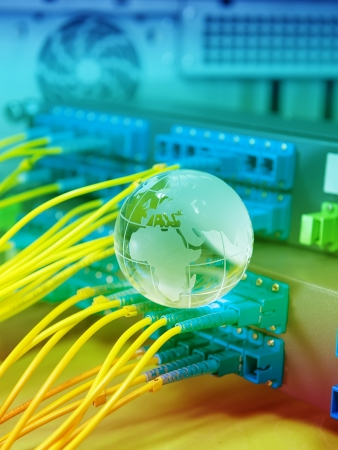 globe with network cables and servers in a technology data center Stock Photo - 18986026