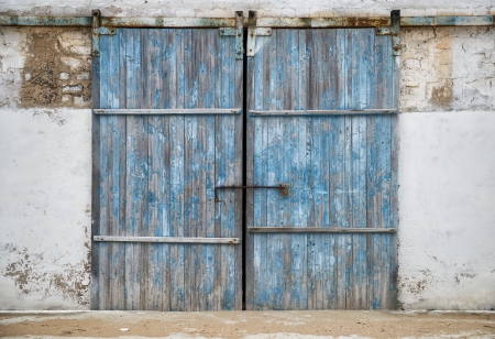 old door: wall of ancient wooden barn with door