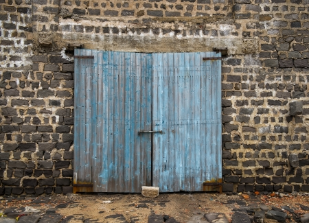 wood abandoned: wall of ancient wooden barn with door