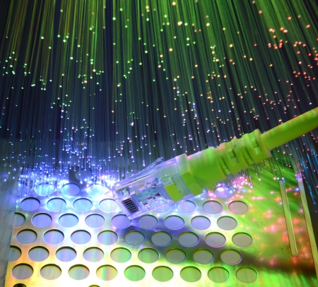 internet  broadband: network cables and hub closeup with fiber optical background