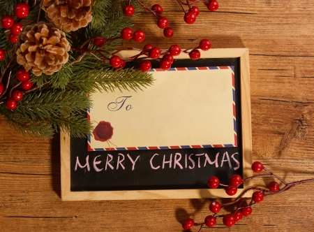 board with Christmas decoration on wooden  photo