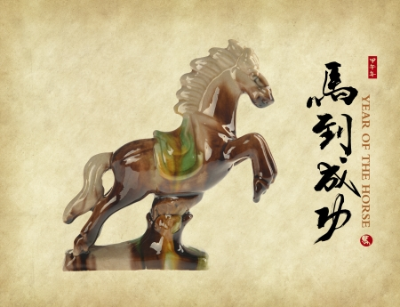 Ceramic horse souvenir on old paper,Chinese calligraphy. word for 'horse', 2014 is year of the horse photo