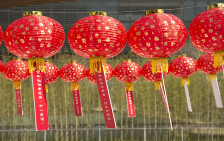 red lanterns with chinese letters printed. It brings good luck and peace to prayer.Guessing Lantern Riddles 版權商用圖片