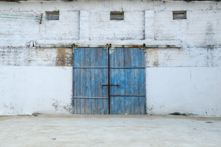 wall of ancient wooden barn with door photo