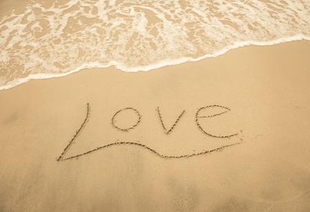 i love u: I love U on the sand texture background Stock Photo