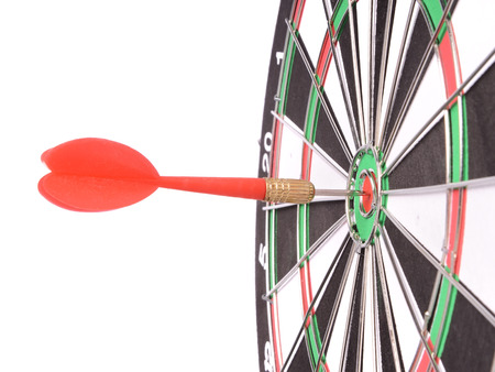 Target aim glossy colored mark with darts in the center photo