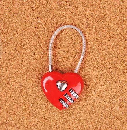 locked up: heart shape lock locked up with wood background Stock Photo