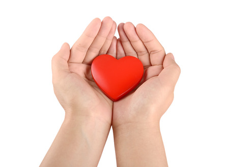 hands holding heart: Hands holding red heart Stock Photo