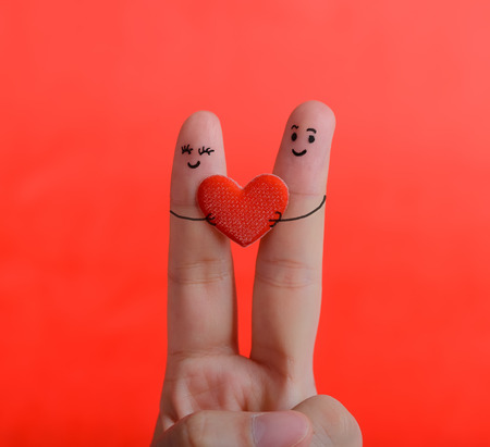 two women hugging: happy couple in love with painted smiley and hugging Stock Photo