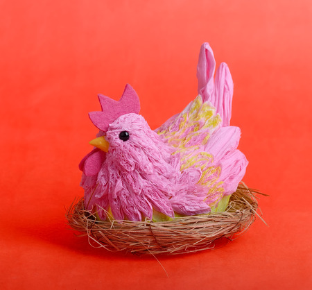 easter hen on red background photo