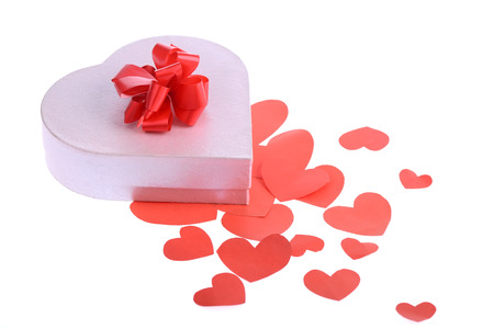 heart shaped stuff: valentine day gift with ribbon and heart shape on white