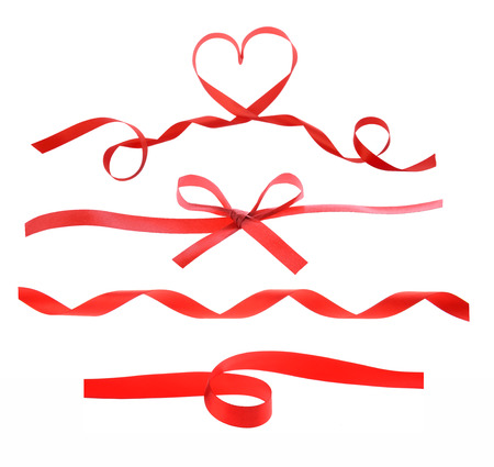 red heart ribbon isolated on white background photo