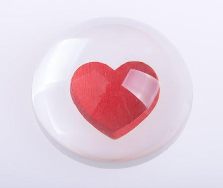 Red heart on glass drops background photo