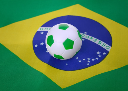 soccer ball with Brazil flag background photo