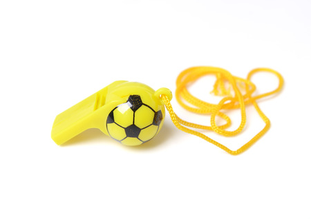 studioshoot: football shape whistle isolated on a white background.