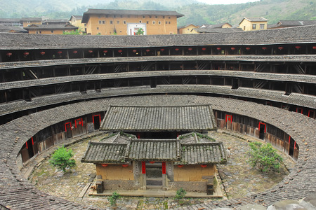 walled: Hakka Roundhouse tulou walled village located in Fujian, China Editorial