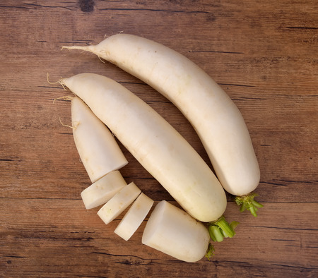 Daikon radish on the wood background photo