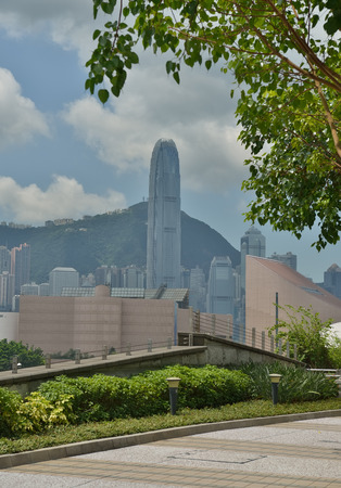 modern business center in hongkong with green tree photo
