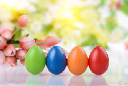 decorated eggs and spring flowers photo