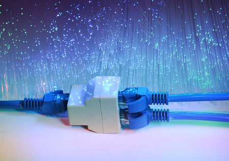 network cables and hub closeup with fiber optical background photo