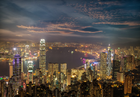 Hong Kong city skyline panorama at night with Victoria Harbor and skyscrapers photo