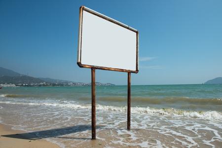 Blank sign against beautiful blue ocean photo