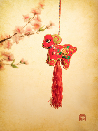 goat peach: chinese goat knot on white background, word for goat, 2015 is year of the goat