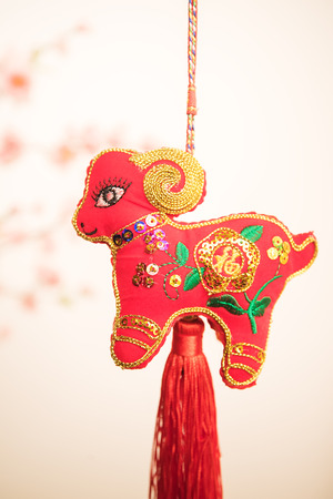 chinese goat knot on white background, word for goat, 2015 is year of the goat