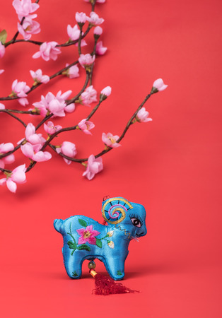 goat peach: chinese goat toy on red background Stock Photo