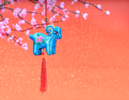 figuration: chinese goat toy on red background Stock Photo