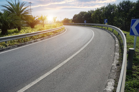 long road: Empty road with slight