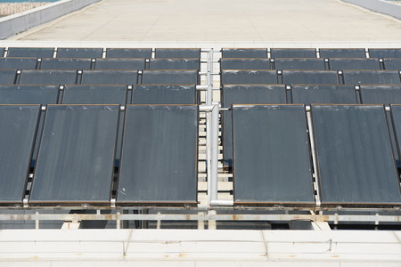 gelio: Solar water heating panel on a house roof Stock Photo