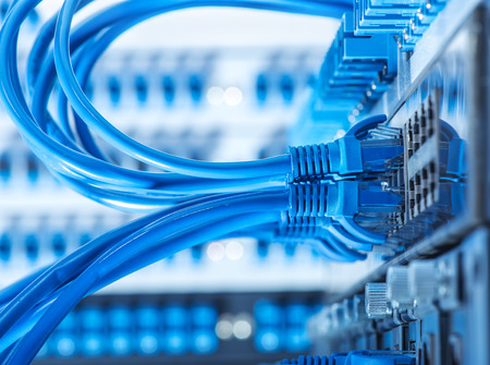 internet  broadband: Network switch and ethernet cables Stock Photo
