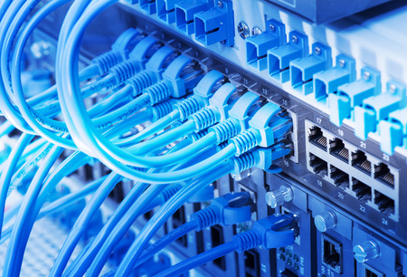 network cables connected to switch Stock Photo