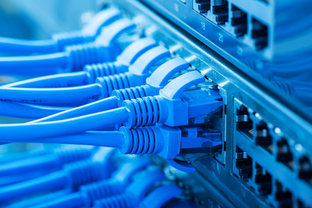 networking cables: Network panel, switch and cable in data center Stock Photo