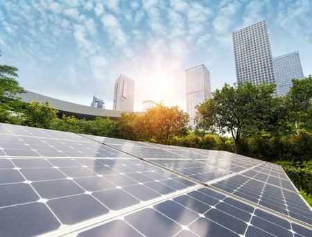 green building: Solar Panels In The Park Of Modern City Stock Photo