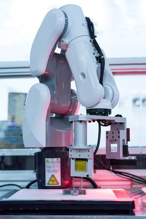 modern manufacturing: Controler of robotic hand Stock Photo