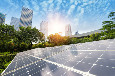 sunshine: Solar Panels In The Park Of Modern City Stock Photo
