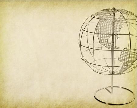 Earth globe on Old antique vintage paper background
