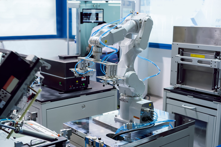 automated process: robotic hand machine tool at industrial manufacture factory