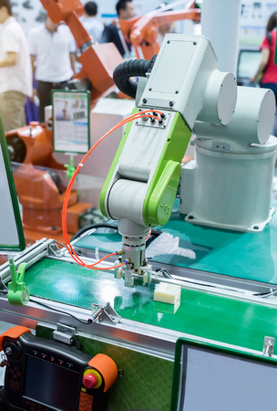 manufacturing: robotic hand machine tool at industrial manufacture factory
