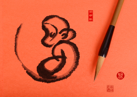 chinese new year decoration: 2016 is year of the monkey,Chinese calligraphy hou. translation: monkey,Red stamps which Translation: good bless for new year